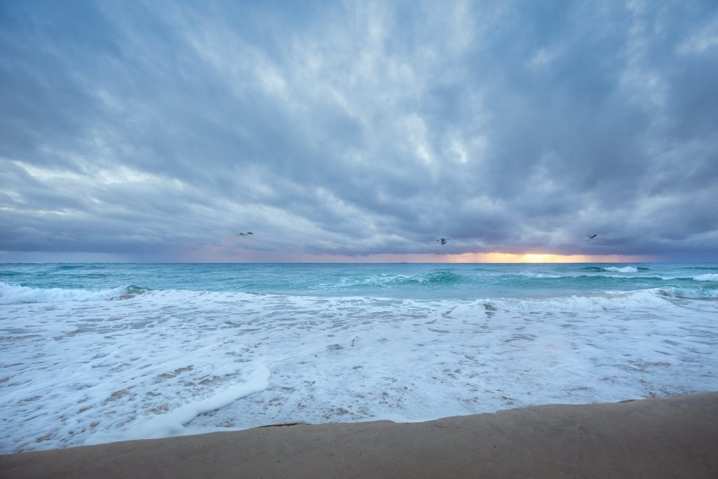 Cloudy morning and stormy seas photograph by Julie Sisco Straddie Photographer artist local