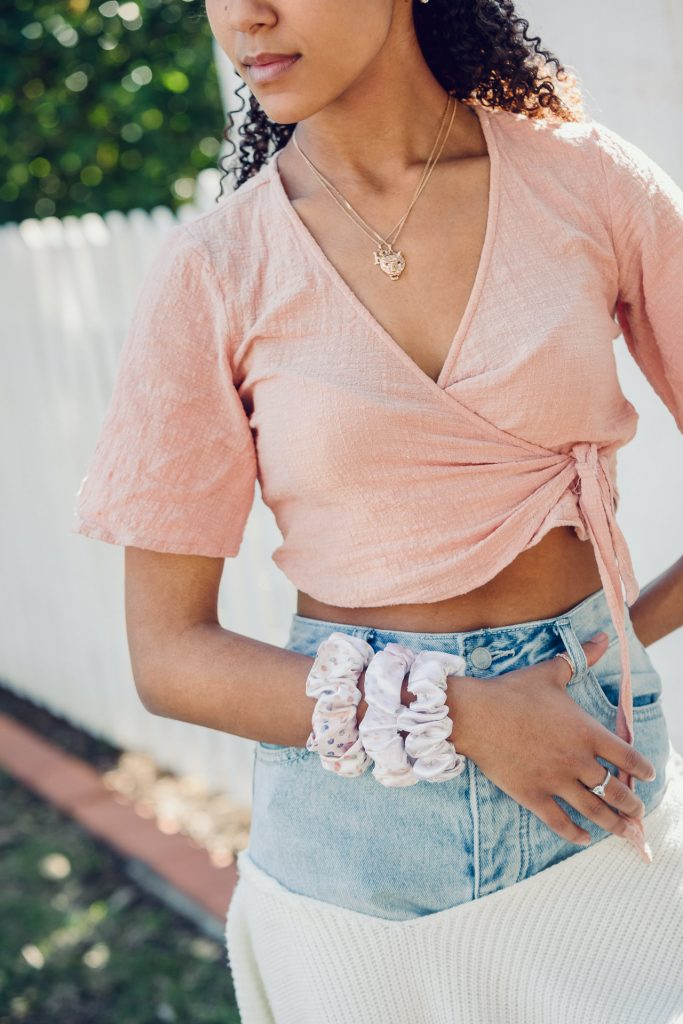 Satin scrunchies worn on the wrist on young lady modellling at a photoshoot